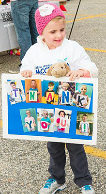 mccp walk child with thank you poster